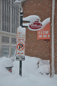 The circulator sign covered in snow