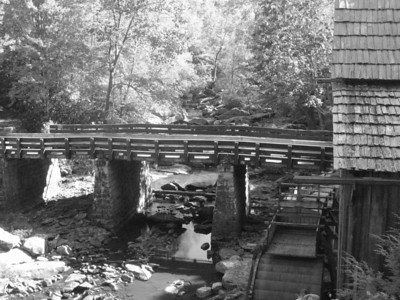 The bridge over Glade Creek in Babcock State Park Westi Virginia.  The river experiences drastic changes in waster level from the spring run off, where this meandering stream turns into a raging Class V rapid.